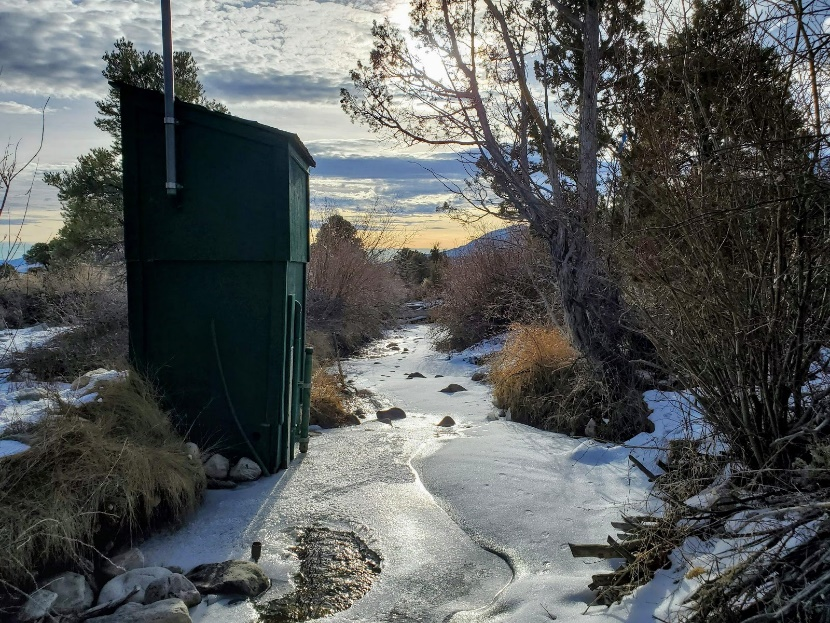 Phhotograph of a stream covered in ice, an example of a stream gage that would be ice-affected.